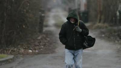homeless man walking